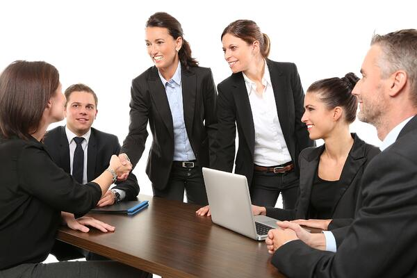 Men and women meeting in an office