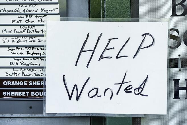 "Laminated handwritten ""Help Wanted"" sign in window of ice cream and yogurt shop in tourist town.jpeg"