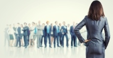Powerful businesswoman standing with back with business team at background-563479-edited.jpeg