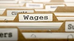 Wages Concept. Word on Folder Register of Card Index. Selective Focus..jpeg