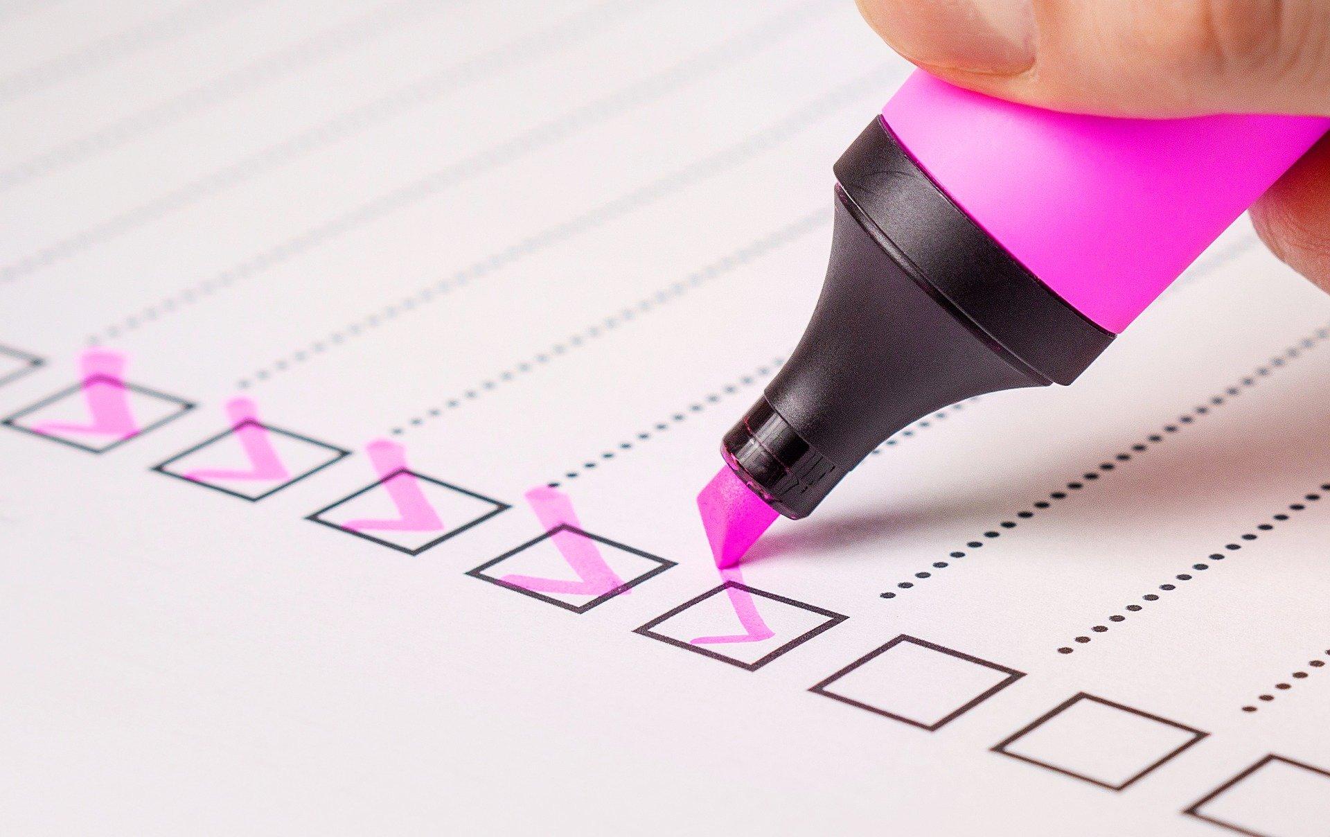 Checklist with pink marker